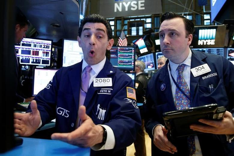 Traders work on the floor of the New York Stock Exchange. REUTERS/Brendan McDermid