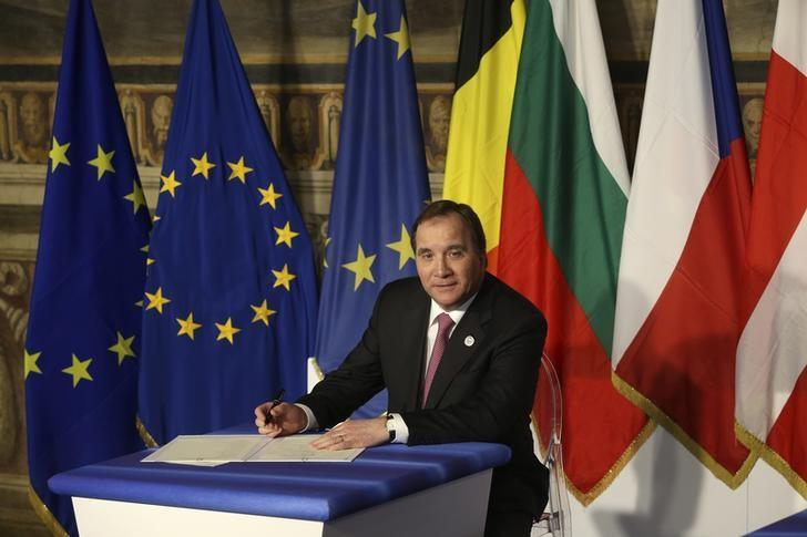 FILE PICTURE: Sweden's Prime Minister Stefan Lofven prepares to sign a document during the EU leaders meeting on the 60th anniversary of the Treaty of Rome, in Rome, Italy March 25, 2017. REUTERS/Remo Casilli