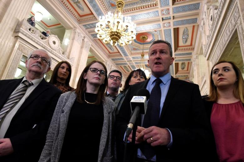 File Picture: Sinn Fein's Conor Murphy (2nd R) speaks to media at Stormont Parliament in Belfast, Northern Ireland, January 16, 2017. REUTERS/Clodagh Kilcoyne