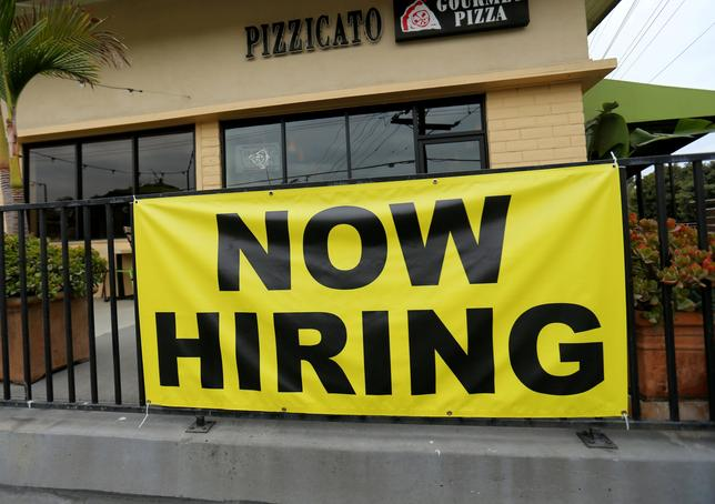 FILE PHOTO: A local pizza restaurant advertises for workers in Encinitas, California, U.S., September 13, 2016. REUTERS/Mike Blake/File Photo