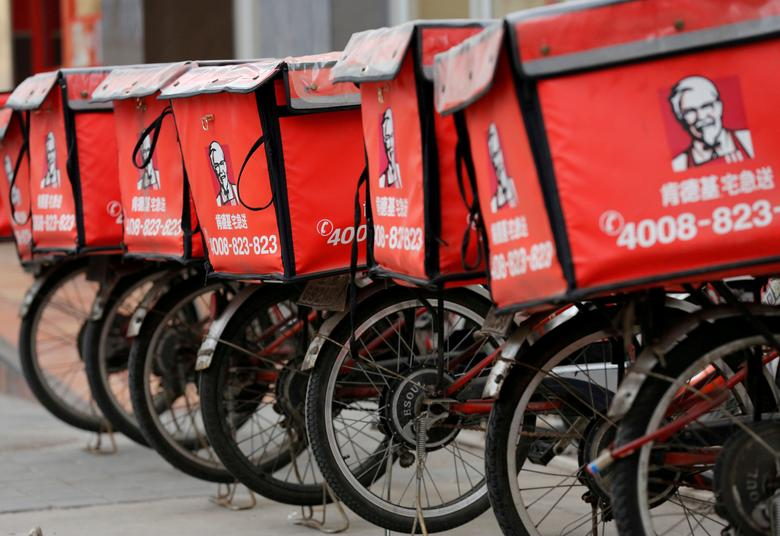 FILE PHOTO: Logos of KFC, owned by Yum Brands Inc, are seen on its delivery bicycles in front of its restaurant in Beijing February 25, 2013.   REUTERS/Kim Kyung-Hoon/File Photo