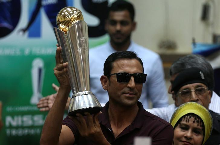 Pakistan's former cricket captain Younis Khan displays the 2017 ICC Champions Trophy during a ceremony at the University of Karachi, Pakistan March 30, 2017. REUTERS/Akhtar Soomro/File Photo