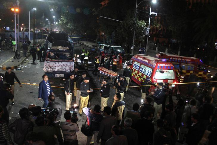 Police and rescue workers work at the scene of a blast in Lahore, Pakistan February 13, 2017. REUTERS/Stringer/File Photo