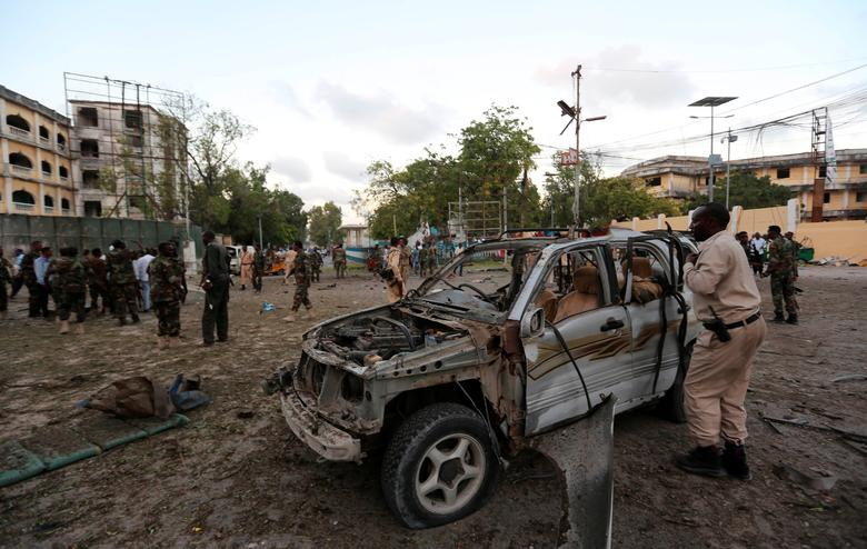 Somali security officers secure the scene of a suicide car explosion in front of the national theatre in Somalia's capital Mogadishu. REUTERS/Feisal Omar