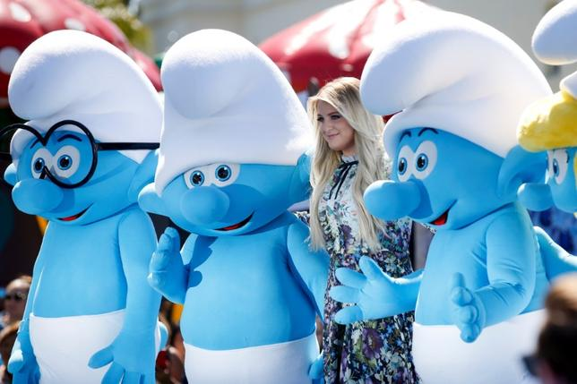 Actor and singer Meghan Trainor poses with smurf characters at the premiere of the film ''Smurfs: The Lost Village'' in Culver City, California, April 1, 2017. REUTERS/Danny Moloshok