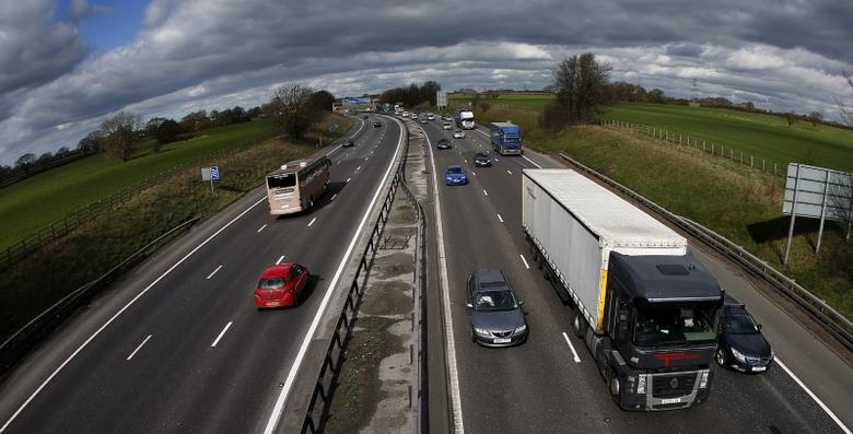 FILE PHOTO - Traffic queues on the M6 motorway near Manchester, northern England March 19, 2012. REUTERS/Phil Noble