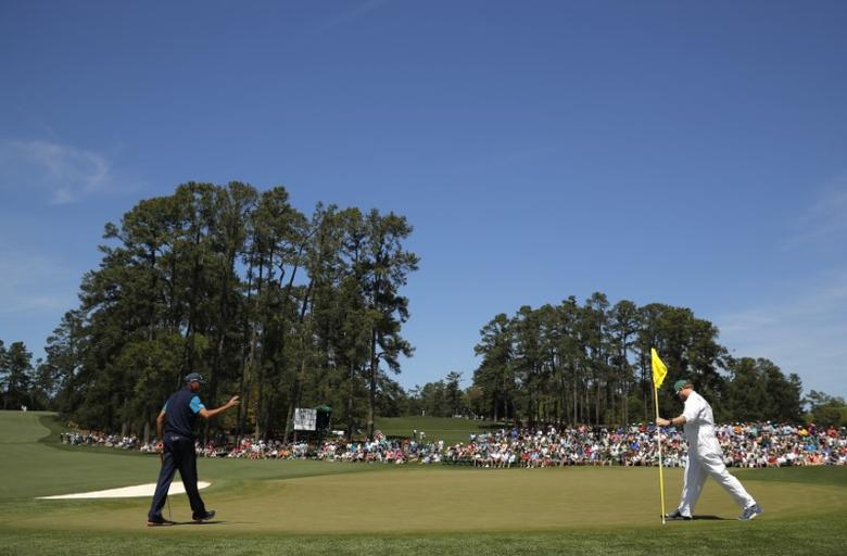 Matt Kuchar of the U.S. sinks a birdie putt on the second hole in final round play during the 2017 Masters golf tournament at Augusta National Golf Club in Augusta, Georgia, U.S., April 9, 2017. REUTERS/Brian Snyder
