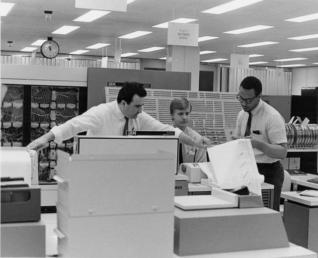 IBM engineers work with a System 360 mainframe computer using business programs written in an early version of the COBOL language in this circa 1960 handout photo obtained by Reuters March 31, 2017.   IBM/Handout via REUTERS