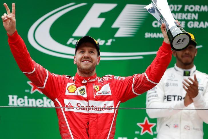 Formula One - F1 - Chinese Grand Prix - Shanghai, China - 09/04/17 - Ferrari driver Sebastian Vettel of Germany celebrates on the podium after the Chinese Grand Prix at the Shanghai International Circuit. REUTERS/Aly Song