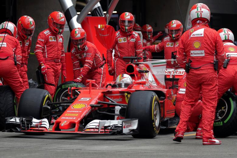 Ferrari's German driver Sebastian Vettel drives his car into the pit lane during the Formula One Chinese Grand Prix in Shanghai April 9, 2017. REUTERS/Andy Wong/Pool