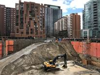 FILE PHOTO: Construction equipment is parked at the bottom of a pit on the site of a new condominium complex off Redpath Avenue in Toronto, Ontario, Canada April 1, 2017.   REUTERS/Chris Helgren/File Photo