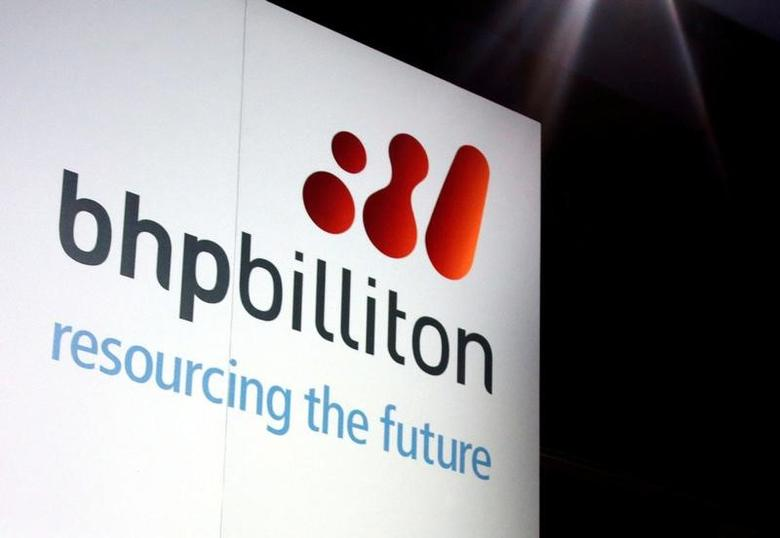 A promotional sign adorns a stage at a BHP Billiton function in central Sydney August 20, 2013.  REUTERS/David Gray/File Photo