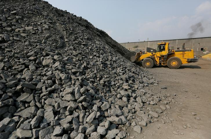 An employee operates a front loader at the Novoangarsky lead and zinc ore dressing plant on a former riverbed of the Angara river near the Siberian settlement of Novoangarsk, Russia, August 17, 2016. REUTERS/Ilya Naymushin/File Photo