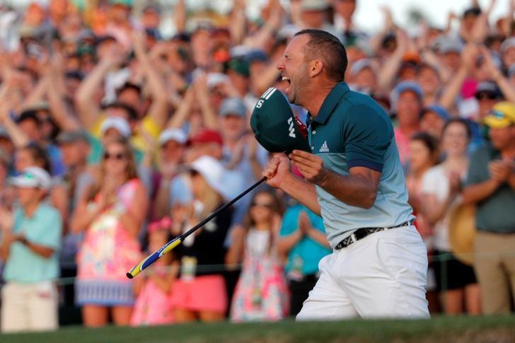 Sergio Garcia of Spain celebrates winning the Masters with a putt on the 18th green during a playoff against Justin Rose of England in the final round of the 2017 Masters golf tournament at Augusta National Golf Club in Augusta, Georgia, U.S. April 9, 2017. REUTERS/Jonathan Ernst