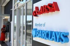 A woman uses an ATM at a branch of Barclays South African subsidiary Absa bank in Johannesburg, in this picture taken  March 6,2016. REUTERS/Siphiwe Sibeko
