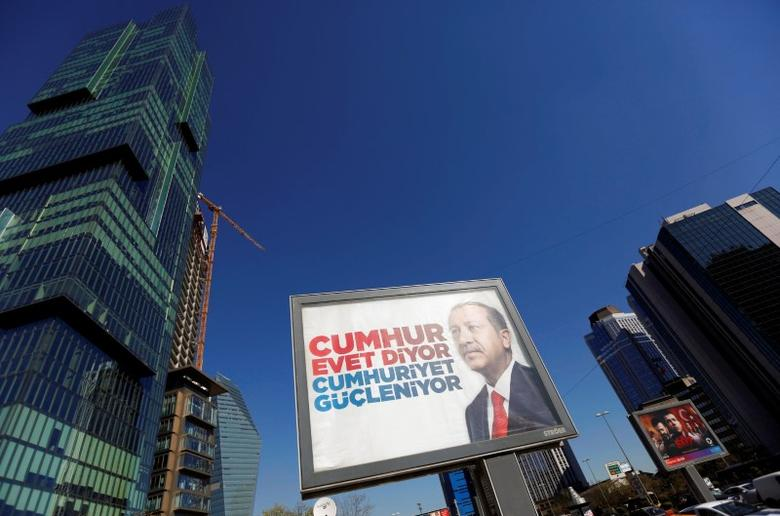 A billboard carrying a picture of Turkish President Tayyip Erdogan and a slogan reading, ''People say Yes, the Republic gets stronger'', is pictured ahead of the constitutional referendum in Istanbul, Turkey, April 11, 2017. REUTERS/Murad Sezer