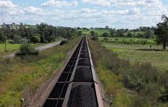 An Aurizon coal train travels through the countryside in Muswellbrook, north of Sydney, Australia, April 9, 2017.   REUTERS/Jason Reed