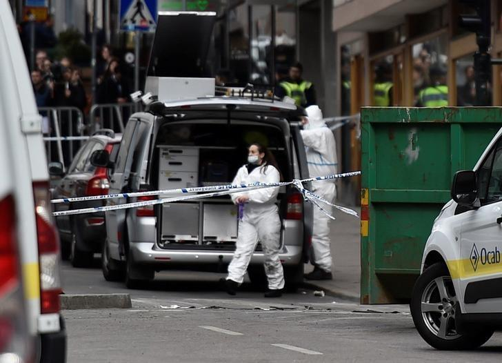 STOCKHOLM 2017-04-08 Forensic police investigators work at the crime scene in central Stockholm on April 08, 2017, the day after a hijacked beer truck plowed into pedestrians on Drottninggatan and crashed into Ahlens department store, killing four people, injuring 15 others. TT News Agency/Noella Johansson/via REUTERS