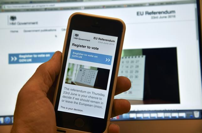 FILE PHOTO - A web page on a voting registration site for the forthcoming British EU referendum is seen on a laptop computer and a smart phone in London, Britain, June 8, 2016. REUTERS/Toby Melville/File Photo