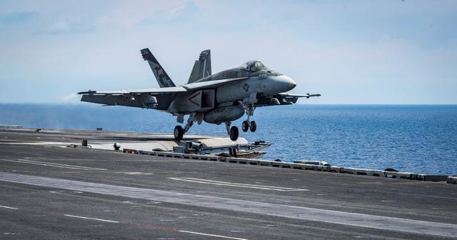 An F/A-18E Super Hornet from the ''Kestrels'' of Strike Fighter Squadron (VFA) 137 takes off from the aircraft carrier USS Carl Vinson (CVN 70) transiting the South China Sea April 10, 2017. Picture taken April 10, 2017. U.S. Navy photo by Mass Communication Specialist 2nd Class Sean M. Castellano/Handout via REUTERS ATTENTION EDITORS - THIS IMAGE WAS PROVIDED BY A THIRD PARTY. EDITORIAL USE ONLY.