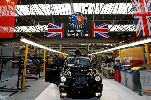 FILE PICTURE: A worker checks a TX4 at the end of the production line at the London Taxi Company in Coventry, central England, September 11, 2013. REUTERS/Darren Staples/File Photo