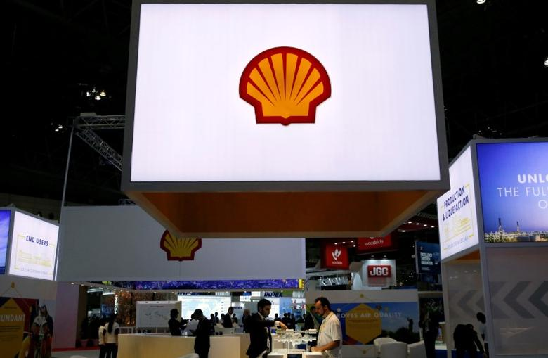 Staff members work at the booth of Royal Dutch Shell at Gastech, the world's biggest expo for the gas industry, in Chiba, Japan, April 4, 2017.    REUTERS/Toru Hanai