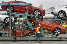 General Motors auto workers load the new Chevrolet Camaro for delivery, at the company's Oshawa Ontario facility April 8, 2009. REUTERS/Fred Thornhill