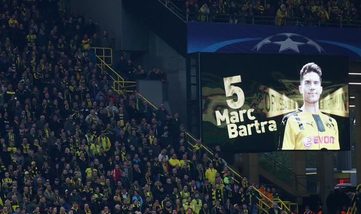 Borussia Dortmund v AS Monaco - UEFA Champions League Quarter Final First Leg - Signal Iduna Park, Dortmund, Germany - 12/4/17 Borussia Dortmund fans look on as a message is displayed in support of Borussia Dortmund's Marc Bartra  Reuters / Kai Pfaffenbach