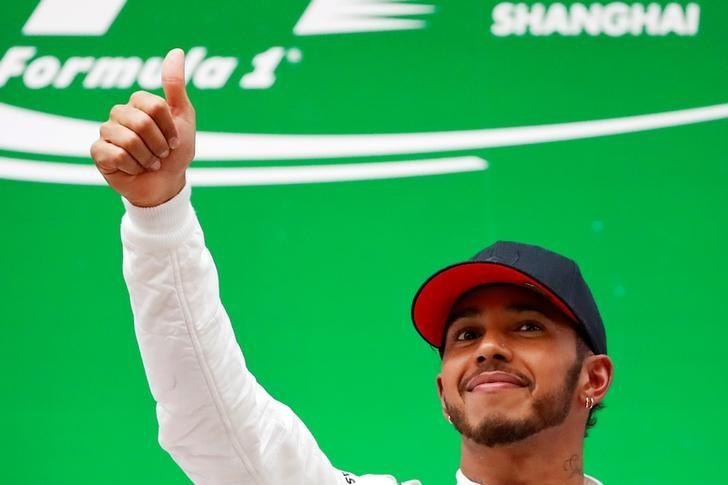 Formula One - F1 - Chinese Grand Prix - Shanghai, China - 09/04/17 - Mercedes driver Lewis Hamilton of Britain celebrates on the podium after winning the Chinese Grand Prix at the Shanghai International Circuit. REUTERS/Aly Song