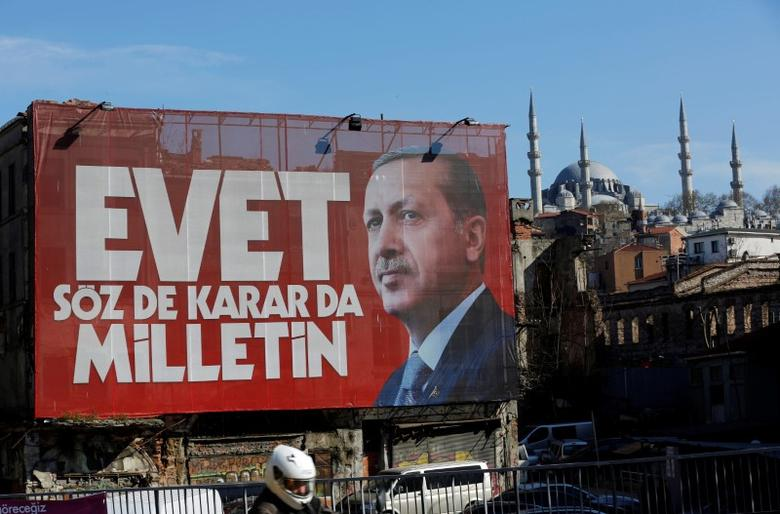 A billboard carrying a picture of Turkish President Tayyip Erdogan and a slogan that reads: ''Yes. It is for the people to speak and to decide'' is seen on a building ahead of the constitutional referendum in Istanbul, Turkey April 13, 2017. REUTERS/Murad Sezer
