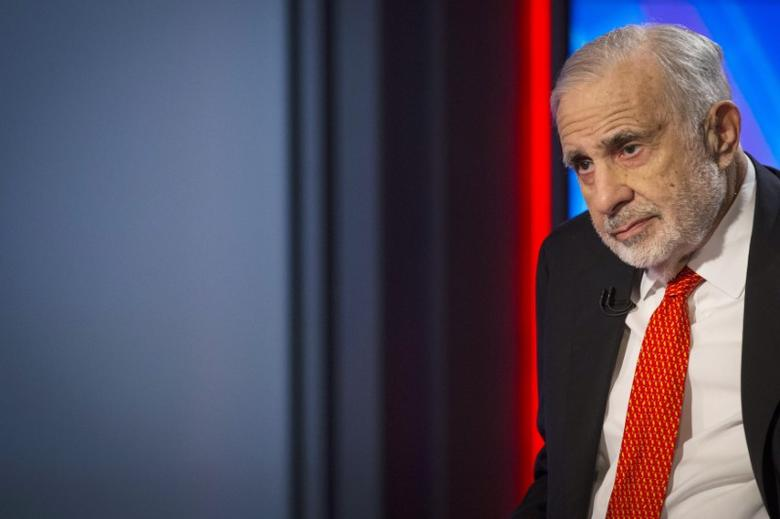 Billionaire activist-investor Carl Icahn gives an interview on FOX Business Network's Neil Cavuto show in New York February 11, 2014.  Icahn has backed off from his campaign urging Apple to increase its stock buybacks, citing the company's recent repurchases as well as an influential proxy adviser's call against his proposal.