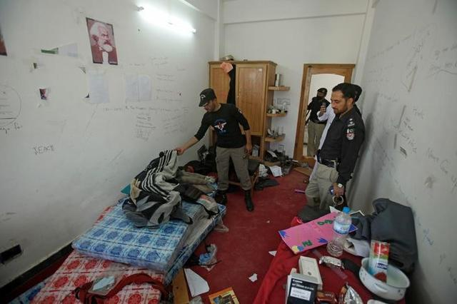 Police search the dorm room of Mashal Khan, accused of blasphemy, who was killed by a mob at Abdul Wali Khan University in Mardan, Pakistan April 14, 2017. REUTERS/Fayaz Aziz