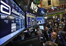 FILE PHOTO: Traders gather at the booth that trades Abbott Laboratories on the floor of the New York Stock Exchange, December 10, 2012.    REUTERS/Brendan McDermid/File Photo