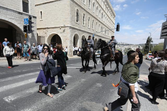 Israeli policemen on horses keep the order following a stabbing attack just outside Jerusalem's Old City, according to Israeli police April 14, 2017. REUTERS/Ammar Awad
