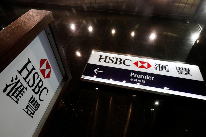 FILE PHOTO: Logos of HSBC are displayed at a major branch at the financial Central district in Hong Kong, China February 21, 2017.  REUTERS/Bobby Yip/File Photo