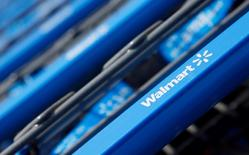 FILE PHOTO - Shopping carts are seen outside a new Wal-Mart Express store in Chicago, Illinois, U.S. on July 26, 2011.   REUTERS/John Gress/File Photo