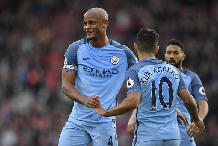 Britain Soccer Football - Southampton v Manchester City - Premier League - St Mary's Stadium - 15/4/17 Manchester City's Sergio Aguero celebrates scoring their third goal with Vincent Kompany  Action Images via Reuters / Tony O'Brien Livepic
