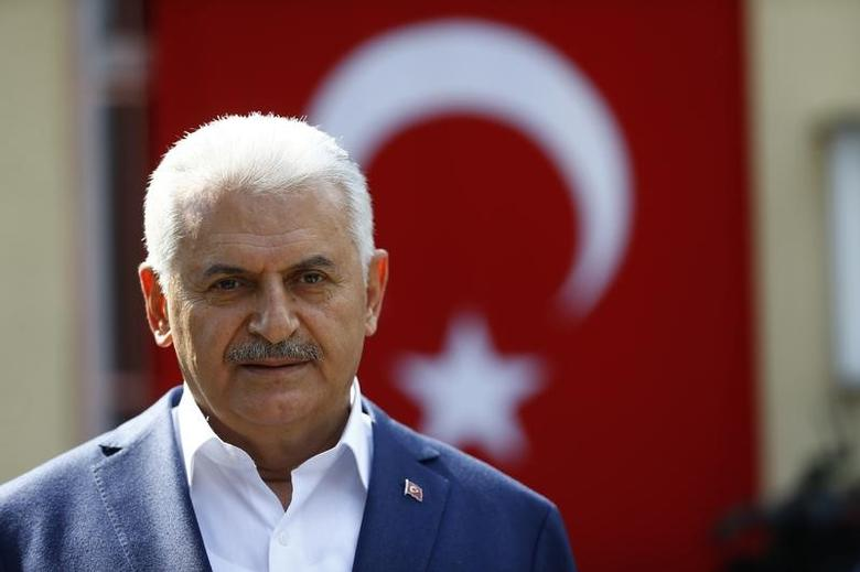 Turkish Prime Minister Binali Yildirim speaks to media next to a polling station during a referendum in the Aegean port city of Izmir, Turkey, April 16, 2017. REUTERS/Osman Orsal