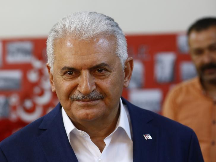 Turkish Prime Minister Binali Yildirim looks on at a polling station during a referendum in the Aegean port city of Izmir, Turkey, April 16, 2017. REUTERS/Osman Orsal