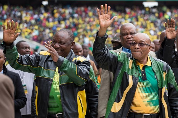 South African President Jacob Zuma (R) and Deputy President Cyril Ramaphosa wave to supporters at a rally to commemorate the 105th birthday of the ruling African National Congress (ANC), in Soweto, South Africa, January 8, 2017. REUTERS/James Oatway/Files