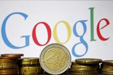 Euro coins are seen in front of a Google logo in this picture illustration taken in Zenica, April 21, 2015. The European Union accused Google Inc on Wednesday of cheating competitors by distorting Internet search results in favour of its Google Shopping service and also launched an antitrust probe into its Android mobile operating system. REUTERS/Dado Ruvic