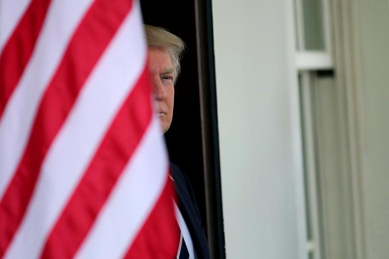 U.S. President Donald Trump waits for the arrival of Egypt's President Abdel Fattah al-Sisi at the White House in Washington, U.S., April 3, 2017. REUTERS/Carlos Barria/Files