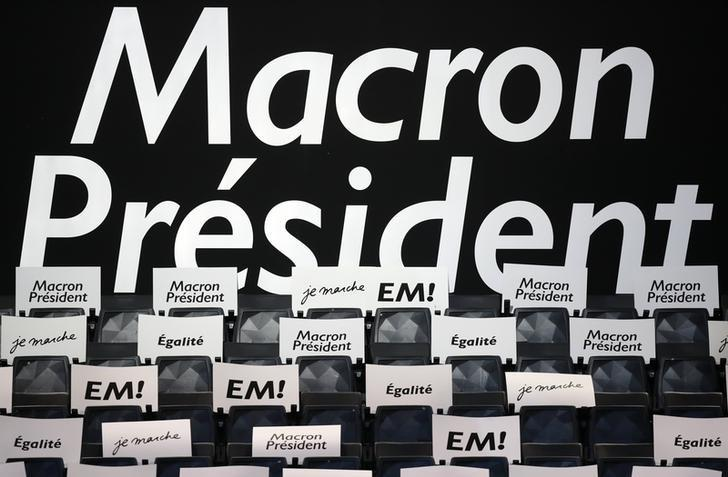 Posters to support Emmanuel Macron, head of the political movement En Marche !, or Onwards !, and candidate for the 2017 French presidential election, are seen on seats inside the AccorHotels Arena before his political rally in Paris, France, April 17, 2017. REUTERS/Christian Hartmann