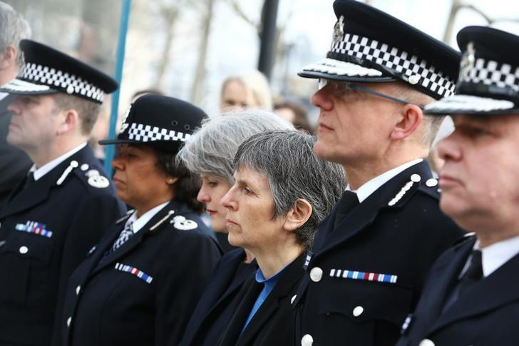 Cressida Dick, incoming Metropolitan Police Commissioner, stands during a minute's silence outside New Scotland Yard the morning after an attack by a man driving a car and weilding a knife left five people dead and dozens injured, in London, Britain, March 23, 2017. REUTERS/Neil Hall