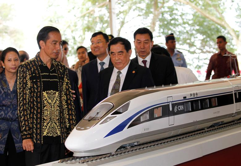 Indonesian President Joko Widodo (2nd L) and the general manager of China Railway Corp. Sheng Guangzu (C) attend a 2016 groundbreaking ceremony for the Jakarta-Bandung fast-train railway line in West Java province, Indonesia. REUTERS/Garry Lotulung
