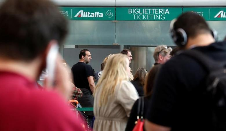 Passengers await their flight during a strike by workers of Italy's national airline, Alitalia at Fiumicino international airport in Rome, Italy April 5, 2017. REUTERS/Remo Casilli