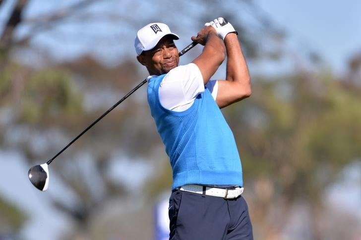 Jan 26, 2017; La Jolla, CA, USA; Tiger Woods tees off the 5th hole during the first round of the Farmers Insurance Open golf tournament at Torrey Pines Municipal Golf Course. Mandatory Credit: Orlando Ramirez-USA TODAY Sports