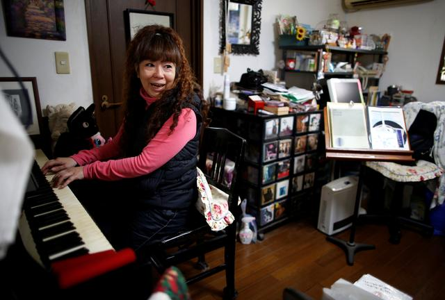 54-y-o Hiromi Tanaka plays piano during an interview with Reuters at her house where she lives with her widowed mother in Tokyo, Japan March 1, 2017.  REUTERS/Issei Kato