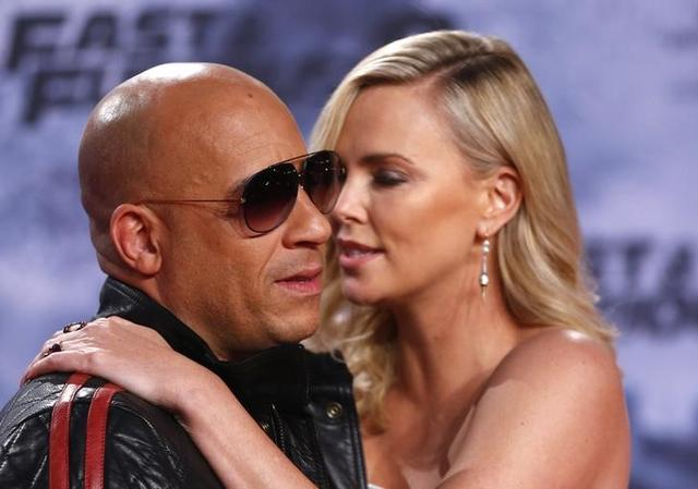 Actors Vin Diesel and Charlize Theron pose at the premiere of ''Fast and Furious 8'' movie in Berlin, Germany, April 4, 2017. REUTERS/Hannibal Hanschke