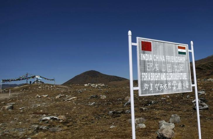 A signboard is seen from the Indian side of the Indo-China border at Bumla, in the northeastern Indian state of Arunachal Pradesh, November 11, 2009. REUTERS/Adnan Abidi/Files